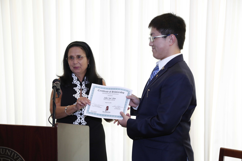 "Renee Borg presents the ATF Student Member Scholarship to Faulkner student Zilian ""Ian"" Chen"