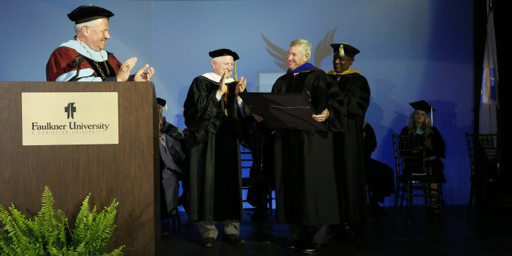 Faulkner University President Mike Williams and Faulkner leadership present Mayor Todd Strange with an honorary Doctor of Humane Letters during the university's fall 2019 Convocation ceremony on Aug. 19
