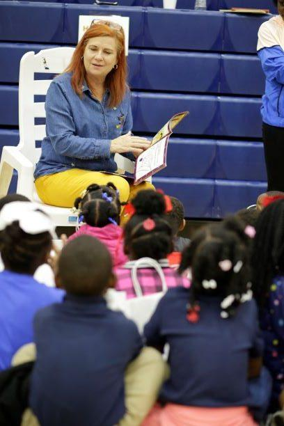 Dr. Cindy Walker reads a spooky story to a class from Davis Elementary School during Faulkner's Fall Festival on Oct. 25.