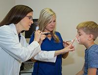 Doctors Examining Young Boy's Eyesight