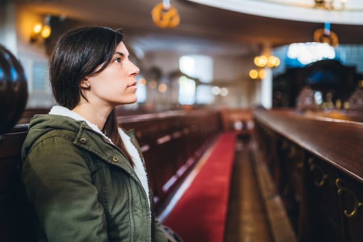 Student sitting in church pew