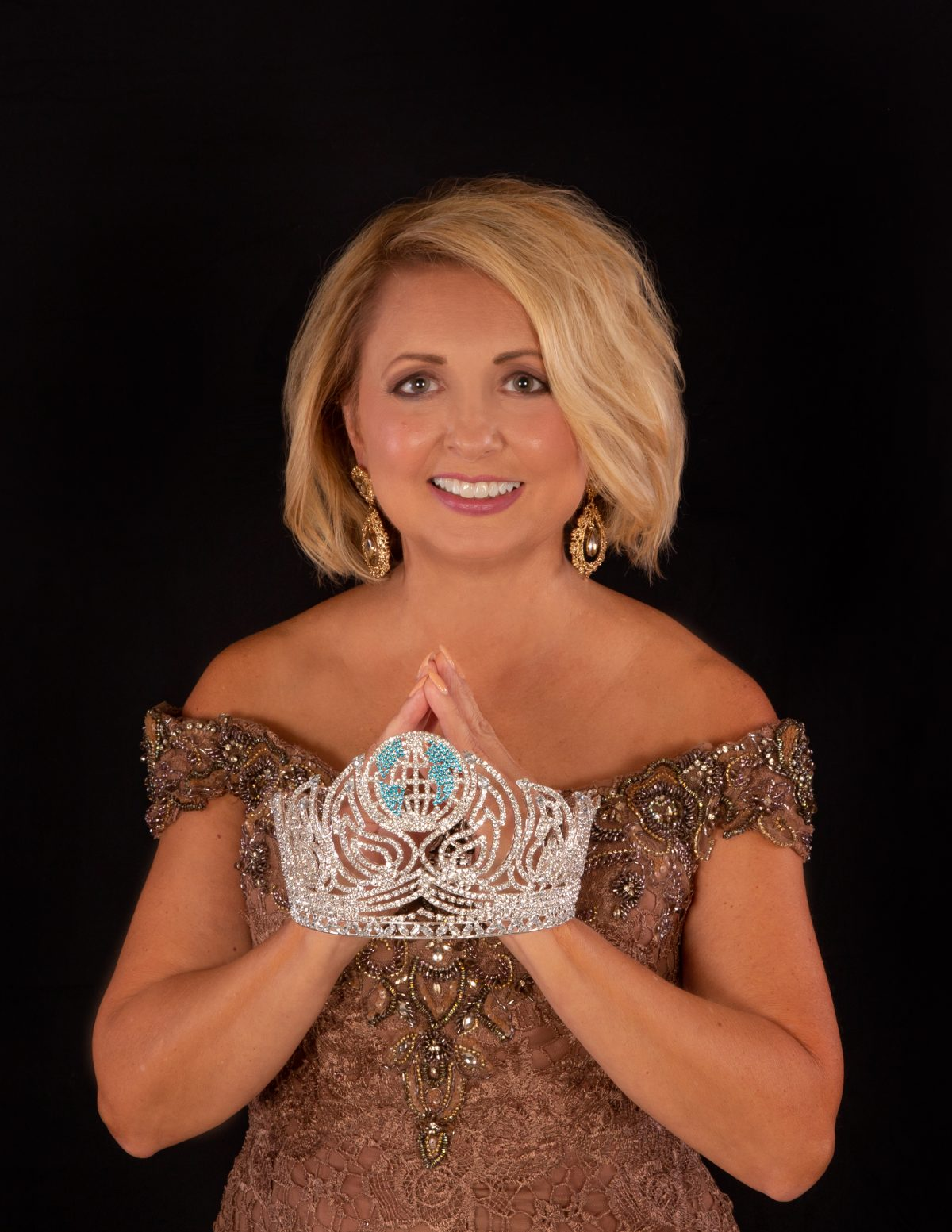 Cindy Dixon. As Ms. Senior Alabama World and Ms Sr. World 60s 1st Alternate, alumna Cindy Dixon is spreading the message of nonprofit, Bucket by Bucket.