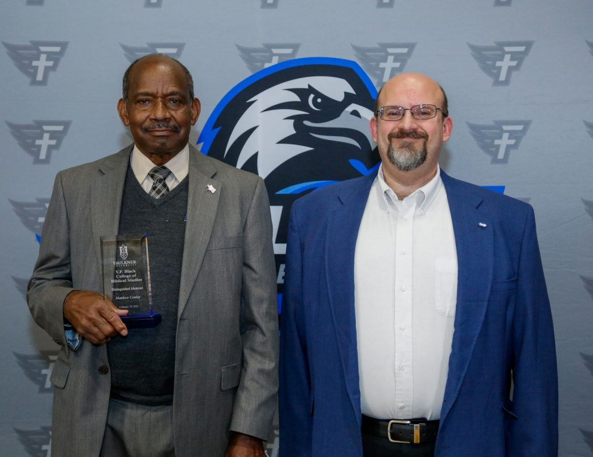 l-r Matthew Conley and Dr. Todd Brenneman pose after Conley was honored during the Marketplace Faith Friday Forums for his service in the classroom and prison ministry.