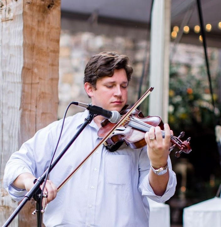 Westley Schlundt plays the violin for an event. As a musician, he was honored as the Faulkner Young Alumnus for the Music Department.