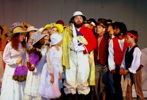 Scene from the Faulkner Dinner Theater play, The Pirates of Penzance featuring Chris Kelly, center.