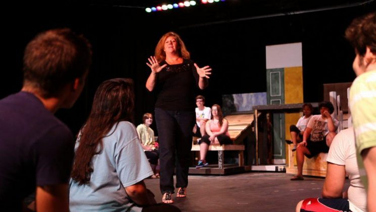 Angie Dickson teaches theatre to students.