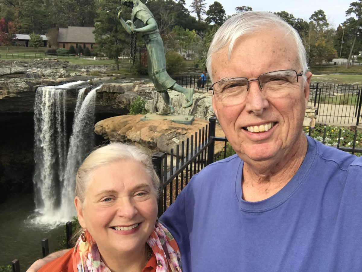 Peggie and Randall Haney share how God's blessings helped them support Faulkner. they pose in front of Noccalula Falls in Gadsden, AL.