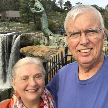 Peggie and Randall Haney pose in front of Naccalula Falls in Gadsden, AL. He shares how God's blessings afforded him the opportunity to support Faulkner.