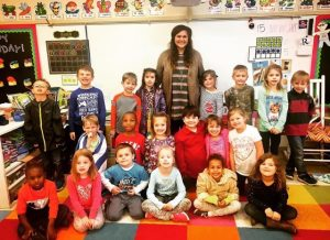 Laura Lambert, center, stands with her kindergarten class at Redland Elementary where she interned and completed her edTPA with