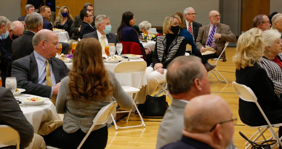 President Mike Williams, left and his wife Lisa Williams, right sit at a table during the President's Circle luncheon on Feb. 18, 2021.
