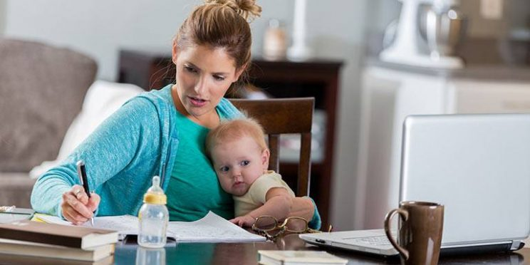online Student Holding Child While Studying